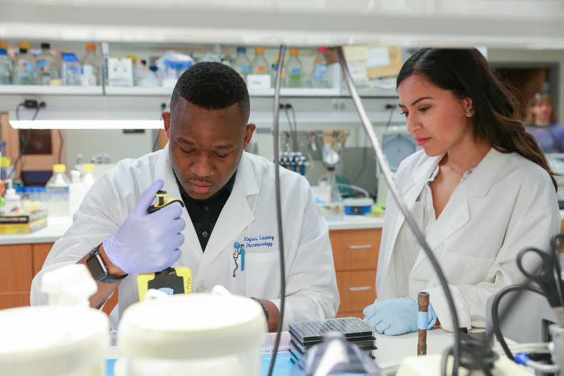 Graduate students in lab, male, female, diversity, doctors